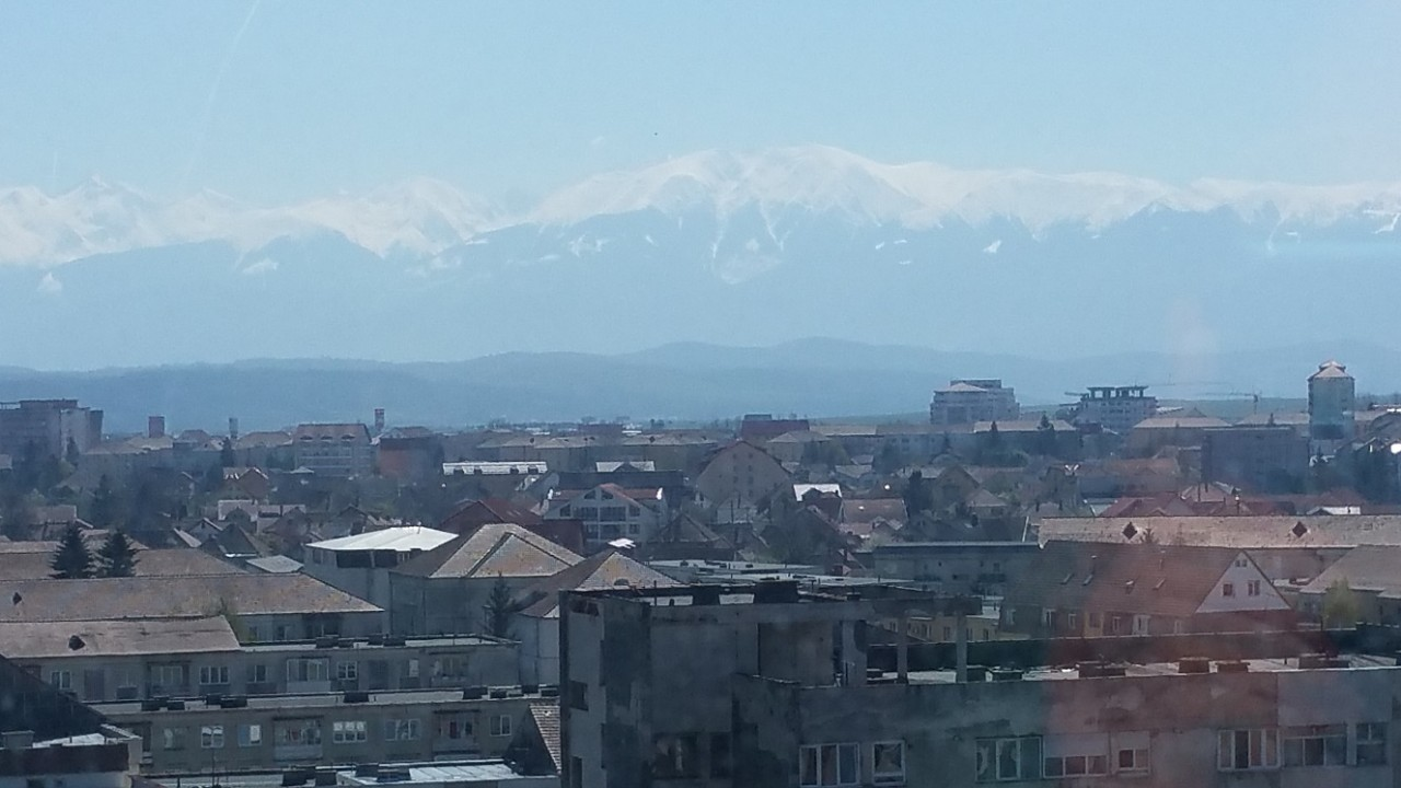 Snowy Carpathian  mountains on a warm sunny day! - Sibiu, Romania