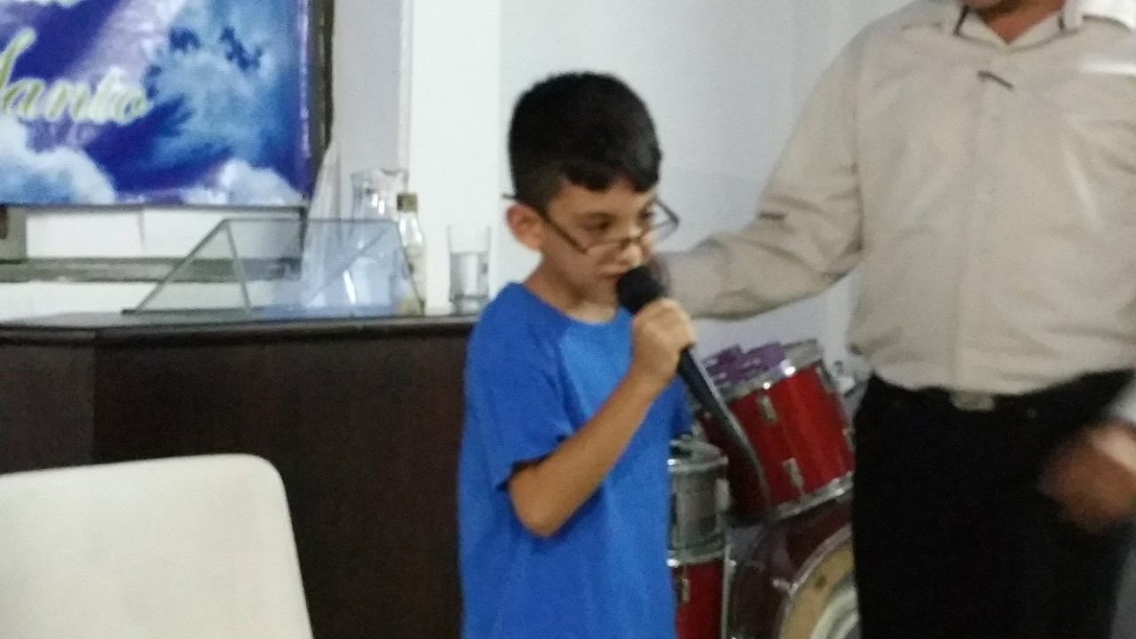 Juan Sebastian and his testimony, peering over the top of his (adult) glasses as he did't need them any more!